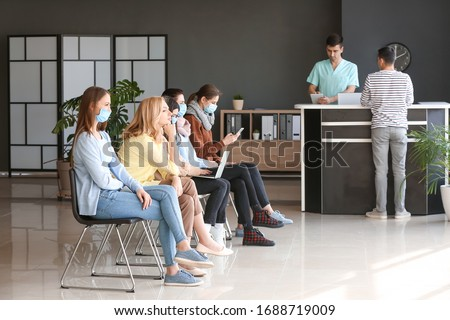 Patients waiting in hall of clinic