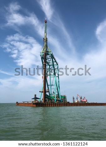 Patimban port, Indonesia, starts from this works. The piling barge is driving piles to construct the berth.
