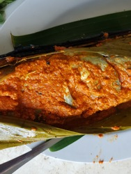 Patin Bakar Bambu is a traditional culinary from  Kalimantan, indonesia.  It is a fish with hot spice and then grilled in the bamboo