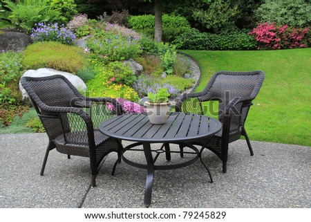 Patio furniture in a beautiful garden.