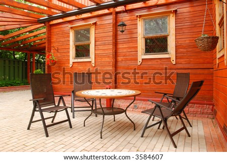 Patio furniture in front of rural house