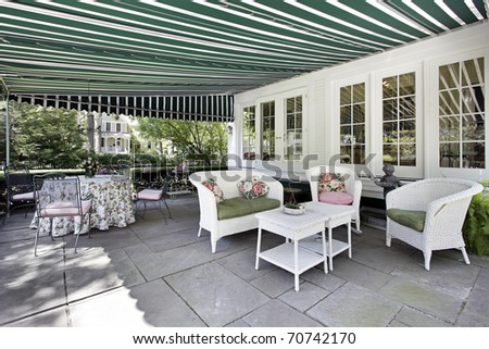 Patio in luxury home with green awning