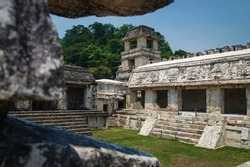 Patio in the Maya temple palace with observation tower with green grass, Palanque, Chiapas, Mexico