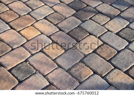 Patio made with paver brick stones in different shades of brown. #675760012