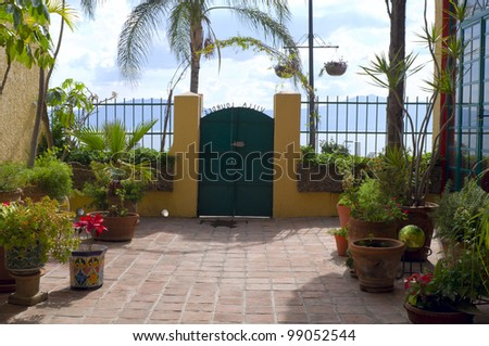 Patio of home in Lourdes neighborhood at Lake Chapala Mexico with mountains on horizon
