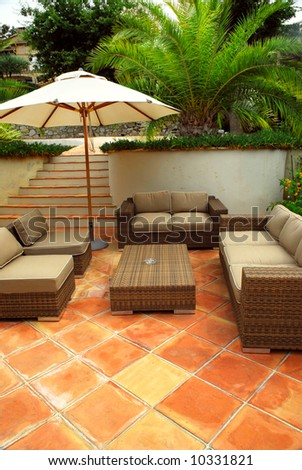 Patio of mediterranean villa in French Riviera with wicker furniture