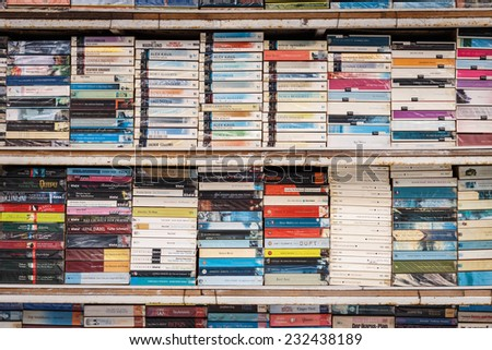 PATONG THAILAND - NOVEMBER 19 : Old books on the shelf for sale at the shop in Patong beach, Patong is a top beach resort town in Phuket, Thailand on November 19, 2014