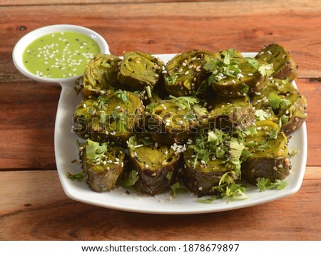 Patra or Alu Vadi or Alu wadi is a popular maharashtrian and Gujarati snack made using colocasia leaves, gram flour and flavourings spices, tamarind, and jaggery, steamed rolls, selective focus Stok fotoğraf ©