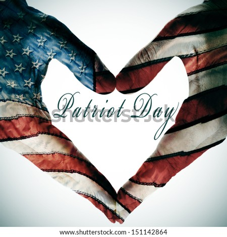 patriot day written in the blank space of a heart sign made with the hands patterned with the colors and the stars of the United States flag #151142864