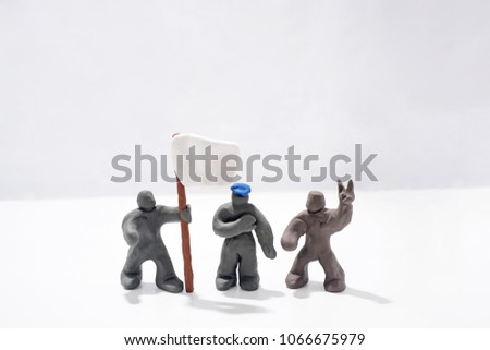 Patriot's Day celebration. Abstract photo. Figures made from Play Clay. Isolated on white background. Demonstration with flags and patriotic symbols. #1066675979