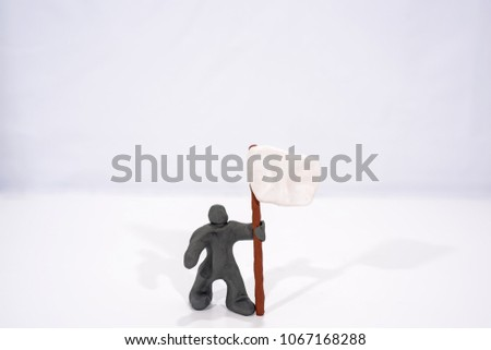Patriot's Day celebration. Abstract photo. Figures made from Play Clay. Isolated on white background. Demonstration with flags and patriotic symbols. #1067168288