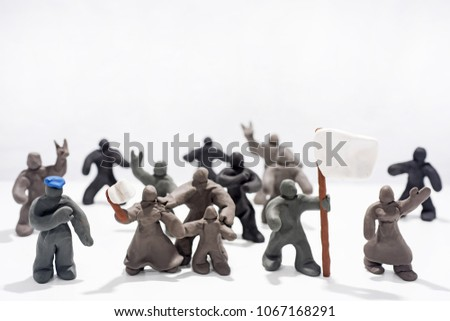 Patriot's Day celebration. Abstract photo. Figures made from Play Clay. Isolated on white background. Demonstration with flags and patriotic symbols. #1067168291