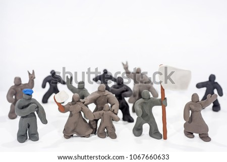 Patriot's Day celebration. Abstract photo. Figures made from Play Clay. Isolated on white background. Demonstration with flags and patriotic symbols. #1067660633