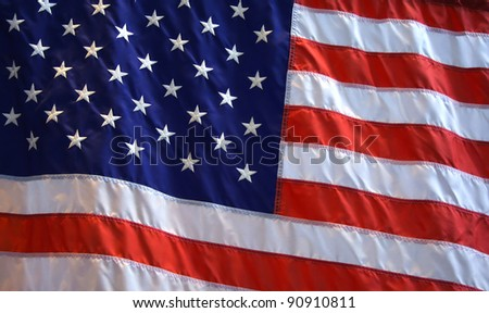 Patriotic American flag background with red, white and blue stars and stripes.