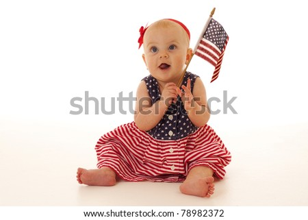 Patriotic baby girl holding a United States flag