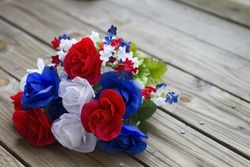 Patriotic colored  flowers on rustic wood