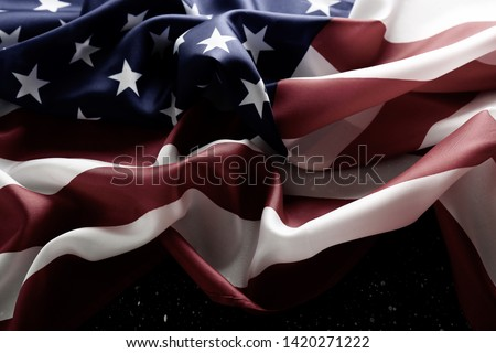 Patriotic composition w/ ruffled American flag on wood planks background. United States of America stars & stripes symbol with copy space. 4th of july Independence day concept. Background, close up #1420271222