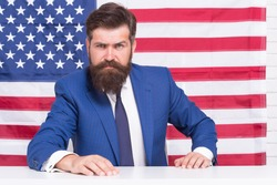 Patriotic education. Patriotic man sit on USA flag background. American patriot. Independence day. 4th of july. Doing patriotic duty. Patriotism and glory. National pride. Feeling patriotic.