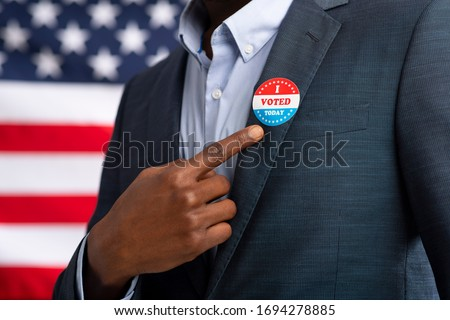 Patriotic elections in America 2020. African American US resident showing with finger on inscription I voted today Stock photo ©
