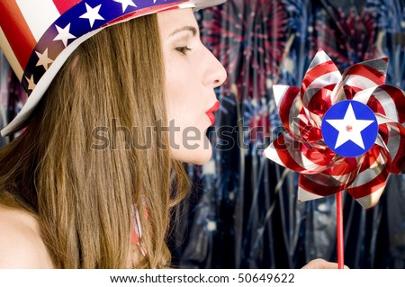 Patriotic Girl with Red, White and Blue Hat and Pinwheel