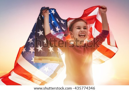 Shutterstock Patriotic holiday. Happy kid, cute little child girl with American flag. USA celebrate 4th of July.