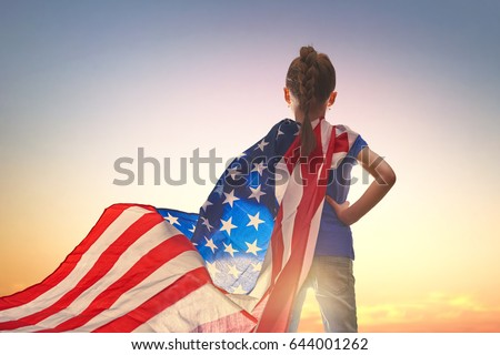 Patriotic holiday. Happy kid, cute little child girl with American flag. USA celebrate 4th of July. #644001262