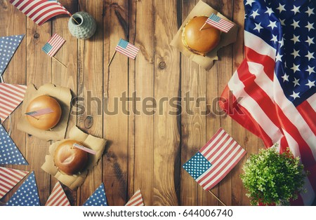 Patriotic holiday. USA are celebrate 4th of July. Top view with American flag on the table. #644006740