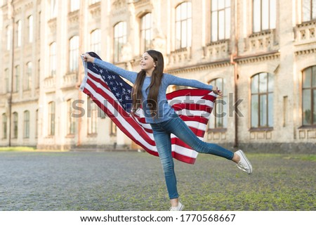 Patriotic upbringing. Patriotic child hold american flag outdoors. Little patriot celebrate Independence day. 4th of july. Patriotic education. Patriotism and national pride. Feeling patriotic.
