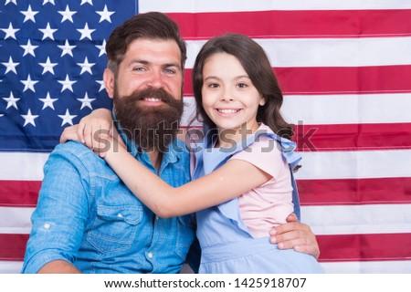 Patriotismt begins at home. Patriotic family showing patriotism on american flag decor. American patriotism. Patriotism and love for the homeland. Independence day. #1425918707