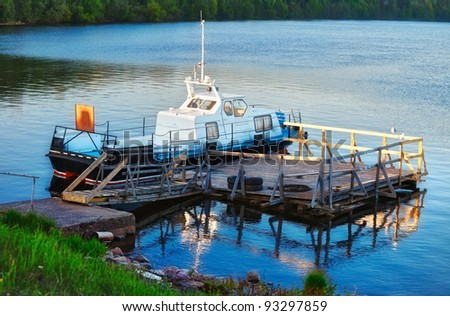 patrol boat docked on calm lake at evening