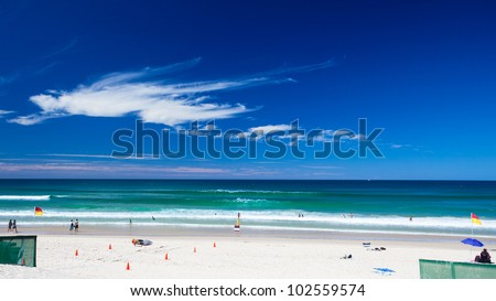 "Patrolled tropical beach with ""swim between the flags"" zone, Gold Coast, Queensland, Australia"