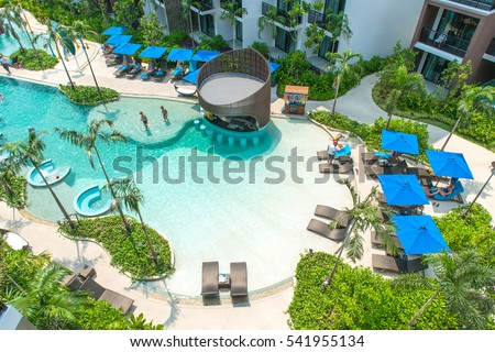 PATTAYA, THAILAND - April 20, 2016: Relaxing In Big Blue Pool. Summer Vacations, at Centra Maris Resort Jomtien. It is luxury hotel, park recreation area. Top View, Pattaya, Thailand, April 20, 2016