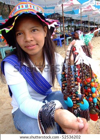 stock photo : PATTAYA, THAILAND - AUGUST 8: Thai woman sells variety of hill