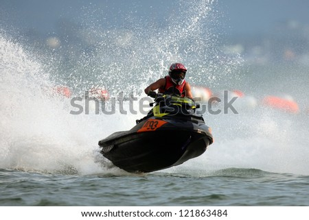 PATTAYA, THAILAND - DECEMBER 7 : Unidentified Malaysian driver number ML 93 in the race of Jet Ski World Cup Grandprix 2012 on December 07, 2012 in Jomthein beach Pattaya, Thailand #121863484