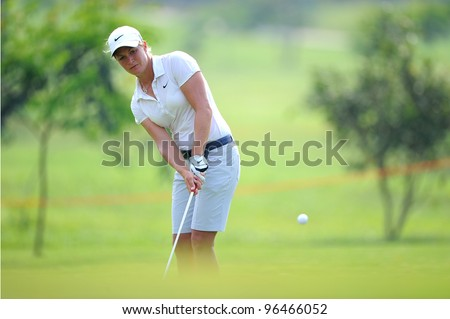 PATTAYA,THAILAND-FEB 16:Suzann Pettersen of the Norway hits a shot during the first round the Honda LPGA 2012 on February 16,2012 at Siam Country Club in Pattaya,Thailand