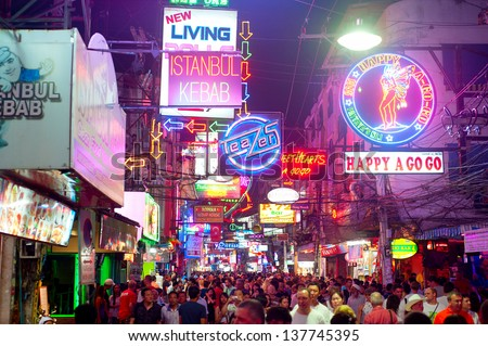 PATTAYA, THAILAND - FEB 20: Unidentified people on a Walking Street on Feb 20, 2013 in Pattaya. Walking Street is a popular tourist attraction. Almost 20 million tourists visited Thailand in 2012.