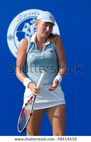 PATTAYA THAILAND - FEBRUARY 9: Alia Kudryavtseva of Russia reacts after losing a point during Round 2 of PTT Pattaya Open 2012 on February 9, 2012 at Dusit Thani Hotel in Pattaya, Thailand