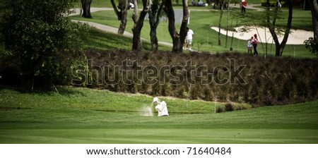 PATTAYA THAILAND - FEBRUARY 20: Australian player Karrie Webb hits the ball out of the bunker during the final round of Honda LPGA Thailand 2011at Siam Country Club Old Course in Pattaya, Thailand