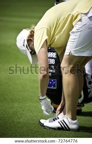 PATTAYA THAILAND - FEBRUARY 19: Australian player Karrie Webb ties her shoes during Day 3 of Honda LPGA Thailand on February 19 2011 at Siam Country Club Old Course in Pattaya, Thailand