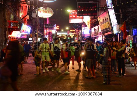 PATTAYA, THAILAND - FEBRUARY 18, 2017 - multicolored neon signs and people on the new Walking Street of the city