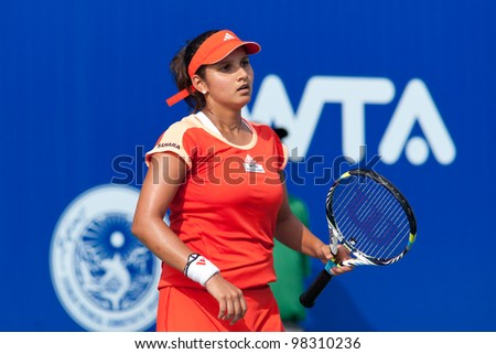 PATTAYA THAILAND - FEBRUARY 9: Sania Mirza of India reacts after losing a point during Round 2 of PTT Pattaya Open 2012 on February 9, 2012 at Dusit Thani Hotel in Pattaya, Thailand