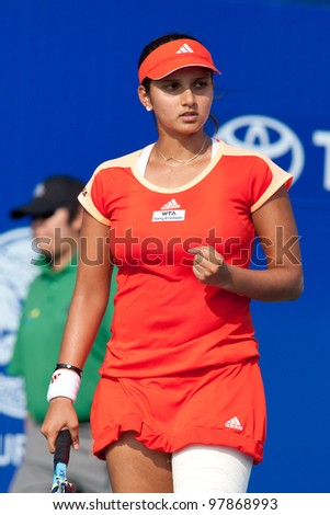 PATTAYA THAILAND - FEBRUARY 9: Sania Mirza of India reacts after winning a point during Round 2 of PTT Pattaya Open 2012 on February 9, 2012 at Dusit Thani Hotel in Pattaya, Thailand