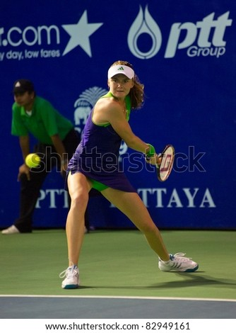 PATTAYA THAILAND - FEBRUARY 12: Slovakian tennis player Daniela Hantuchova returns the ball during semi-final round of PTT Pattaya Open on February 12, 2011 at Dusit Thani Hotel in Pattaya, Thailand