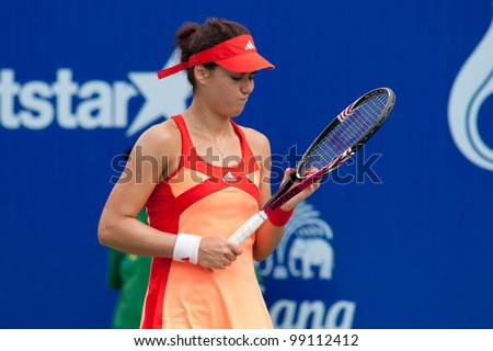 PATTAYA, THAILAND - FEBRUARY 10: Sorana Cirstea of Romania reacts after losing a point during Round 3 of PTT Pattaya Open 2012 on February 10, 2012 at Dusit Thani Hotel in Pattaya, Thailand