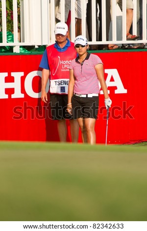 PATTAYA THAILAND - FEBRUARY 20: Taiwanese golf player Yani Tseng thinks of her next move on day 4 of Honda LPGA Thailand 2011on February 20, 2011 at Siam Country Club Old Course in Pattaya, Thailand - stock photo