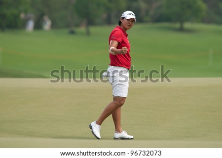 PATTAYA, THAILAND-FEBRUARY 17: Yani Tseng of Taiwan celebrates a point during Round 2 of Honda LPGA 2012 on February 17, 2012 at Siam Country Club Old Course in Pattaya, Thailand