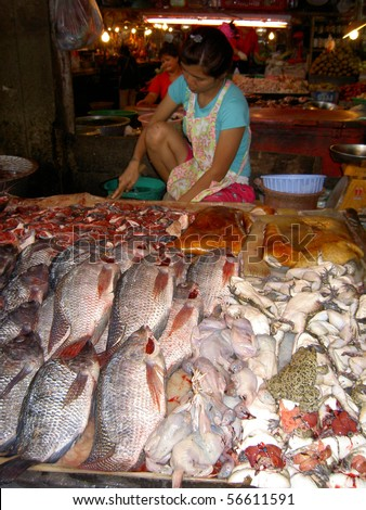 stock photo : PATTAYA, THAILAND - JUNE 2: Thai woman sells fish in a