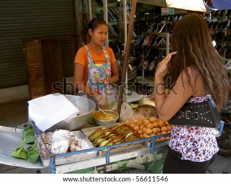 PATTAYA, THAILAND - JUNE 2: Thai woman sells Thai snacks in a market on June 2, 2005 in Pattaya. - stock photo