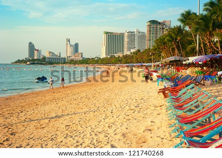 PATTAYA, THAILAND - MARCH 16: People walking along the beach on March 16, 2012 in Pattaya, Thailand. Almost 20 million tourists visited Thailand in 2012.