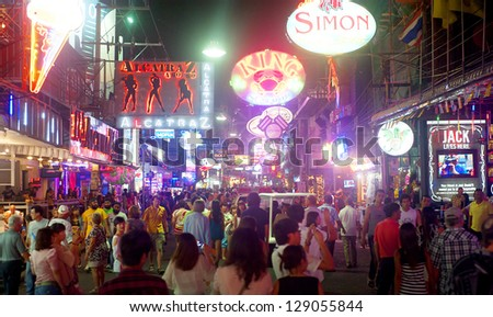 PATTAYA, THAILAND - MARCH 13: Unidentified people on a Walking Street on March 13, 2012 in Pattaya. Walking Street is a popular tourist attraction. Almost 20 million tourists visited Thailand in 2012.